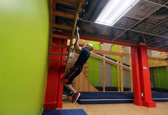 Noel Reyes, Ninja trainer at Westchester Gym in Elmsford, completes the ring toss obstacle in the new Ninja Warrior Room at the gym Aug. 17, 2018. Many of the obstacles in the room are replicas of the obstacles contestants on the American Ninja Warrior television show must successfully complete. Reyes has been a contestant on the show multiple times.