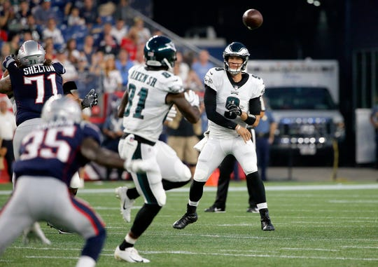 Philadelphia Eagles quarterback Nick Foles (9) passes to wide receiver Kamar Aiken (81) during the first half of a preseason NFL football game against the New England Patriots, Thursday, Aug. 16, 2018, in Foxborough, Mass. (AP Photo/Mary Schwalm)