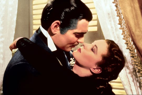 "Long regarded as one of the all-time great films, ""Gone With the Wind"" (starring Clark Gable, left, and Vivien Leigh) has also attracted criticism for romanticizing slavery and the Confederacy. It will screen in Memphis at two Malco theaters as part of an 80th anniversary re-release."