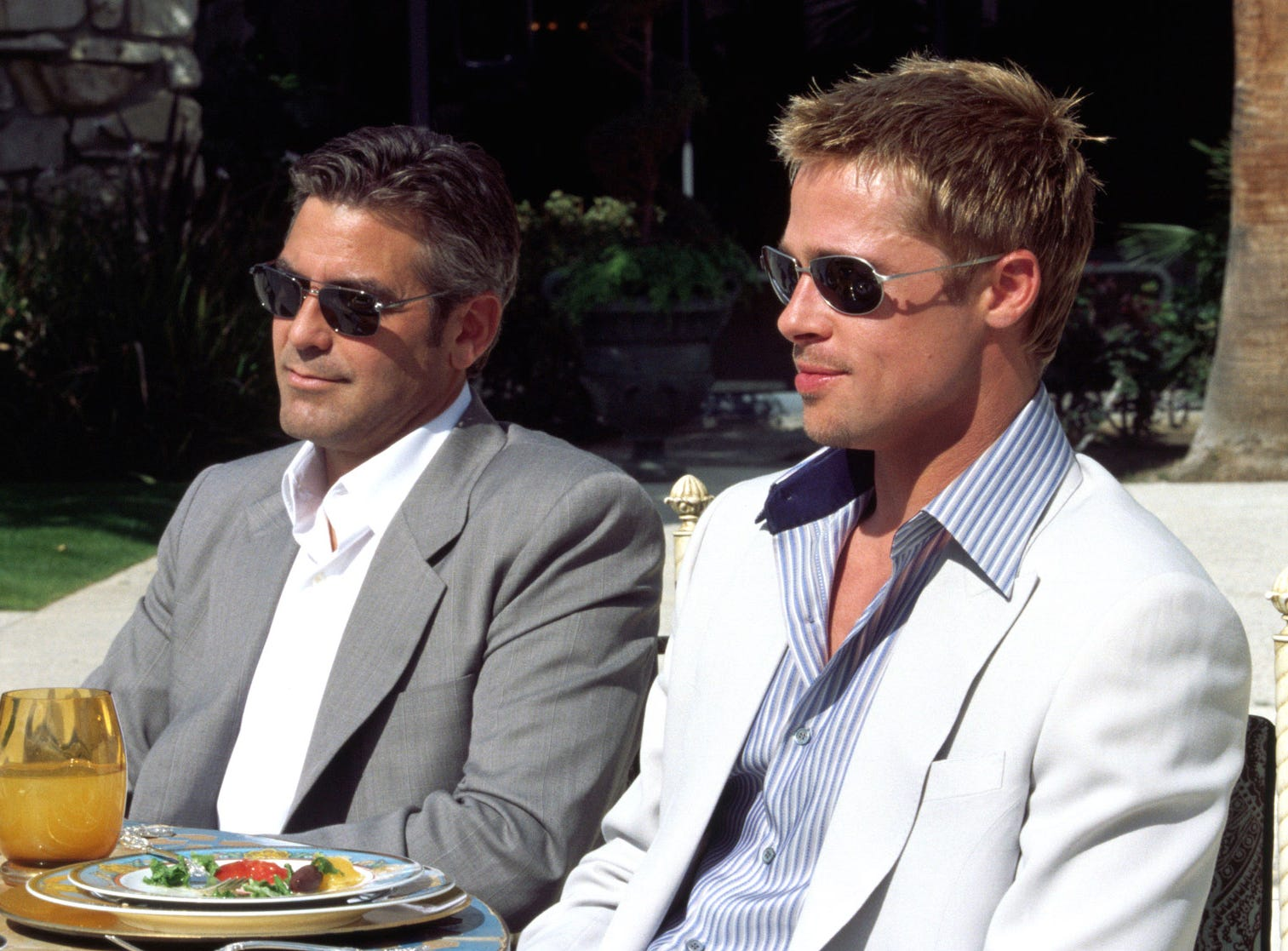 'Ocean's 11': George Clooney and Brad Pitt in a scene from the 2001 reboot of the Frank Sinatra caper. Nothing says over-the-top style like a gorgeous cast pulling off a heist in a posh Las Vegas hotel.
