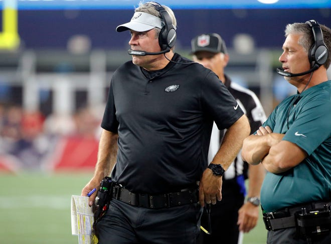 Philadelphia Eagles head coach Doug Pederson, left, and defensive coordinator Jim Schwartz watch from the sideline during the first half of a preseason NFL football game, Thursday, Aug. 16, 2018, in Foxborough, Mass. (AP Photo/Mary Schwalm)