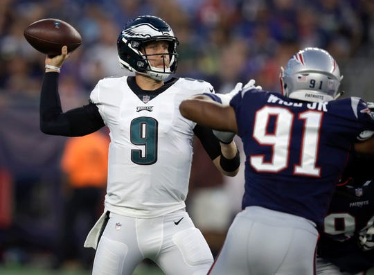 Philadelphia Eagles quarterback Nick Foles (9) passes under pressure from New England Patriots defensive end Deatrich Wise (91) during a preseason game Aug. 16 in Foxborough, Mass. AP Photo/Charles Krupa
