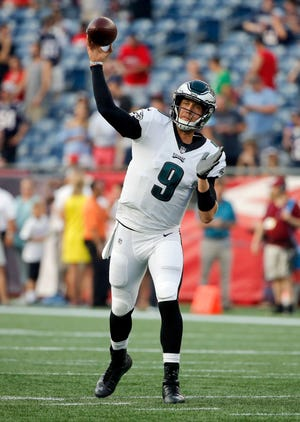Philadelphia Eagles quarterback Nick Foles warms up before a preseason NFL football game against the New England Patriots, Thursday, Aug. 16, 2018, in Foxborough, Mass. (AP Photo/Mary Schwalm)