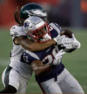 Philadelphia Eagles cornerback Avonte Maddox, rear, tackles New England Patriots tight end Will Tye during the first half of a preseason NFL football game, Thursday, Aug. 16, 2018, in Foxborough, Mass. (AP Photo/Charles Krupa)