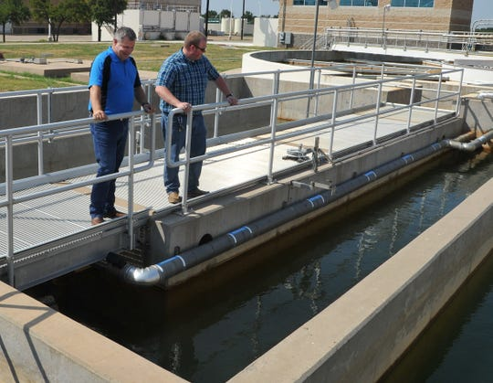 City of Wichita Falls, Public Utilities Operation Manager, Daniel Nix, left, and Water Laboratory Supervisor, Hunter Adams looks over the Cypress Water plant settling pond Friday morning.
