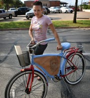Teaching Artist Amber Scott rolls out one of the 2018 Art Bikes painted and decorated with leather.