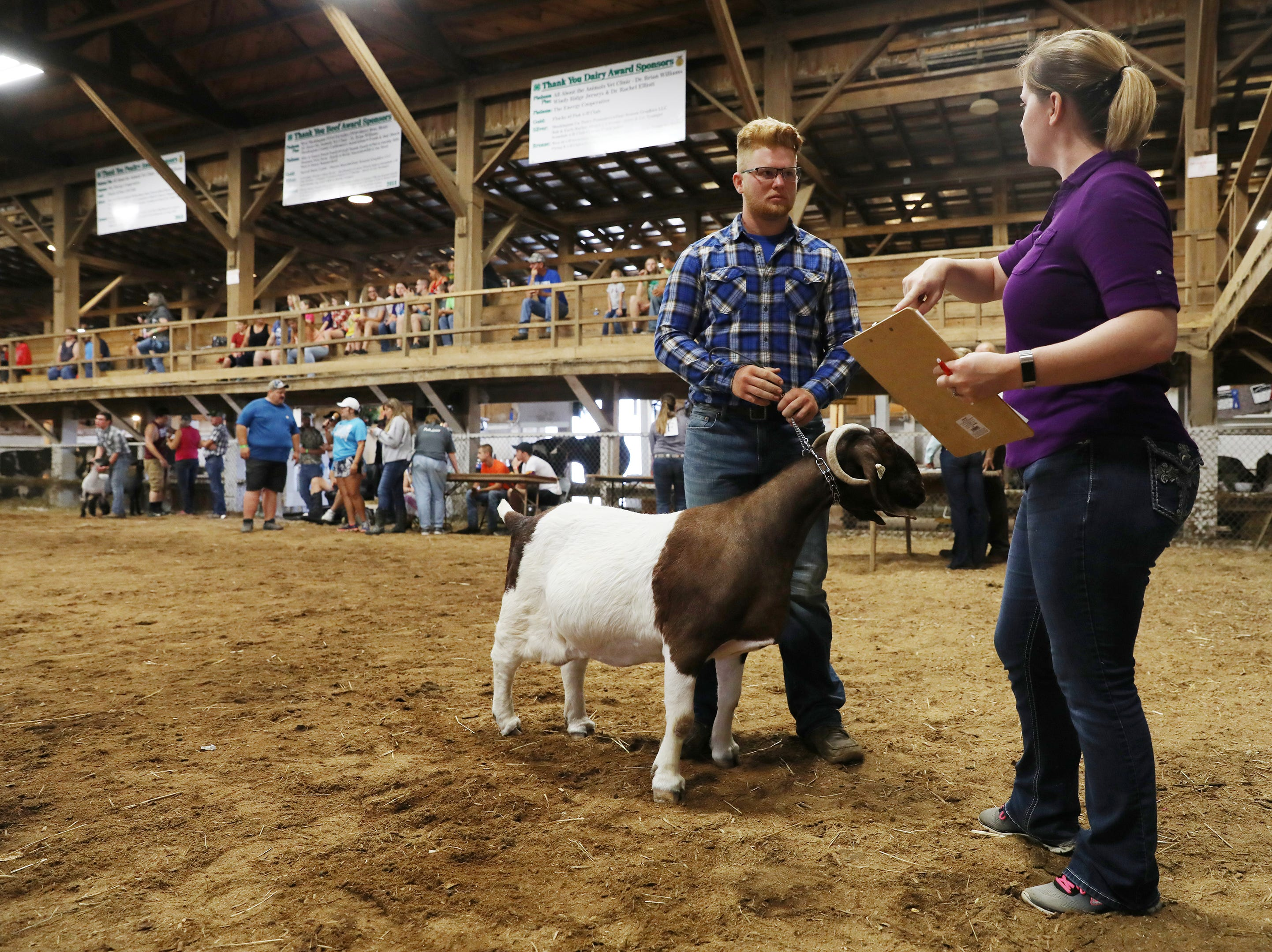 Tyler McKenzie gets ready to show a goat during the Showman of Showmen competition at the Muskingum County Fair on Friday.