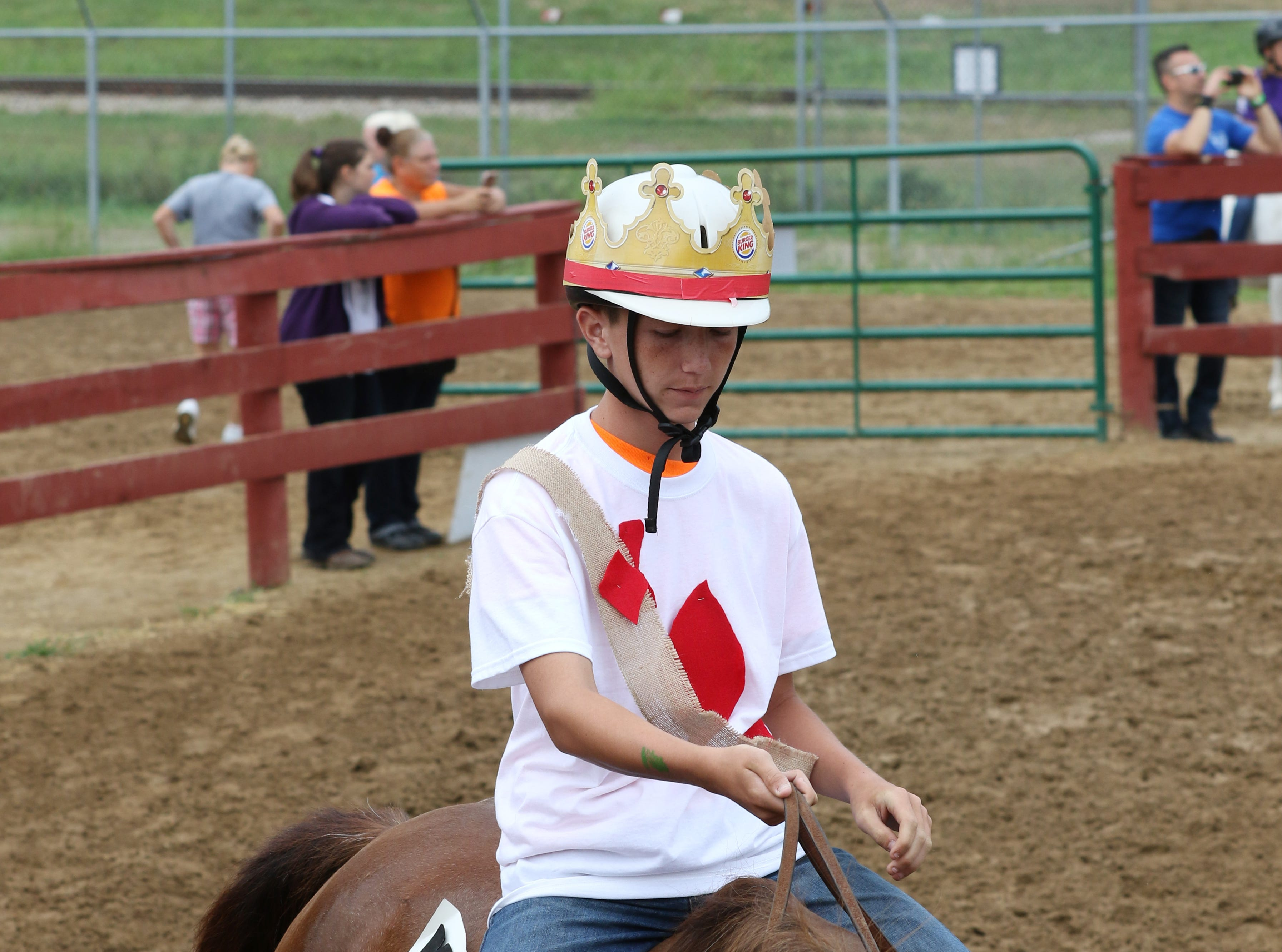Contestants take part in the dress up horse show at the Muskingum County Fair on Friday.