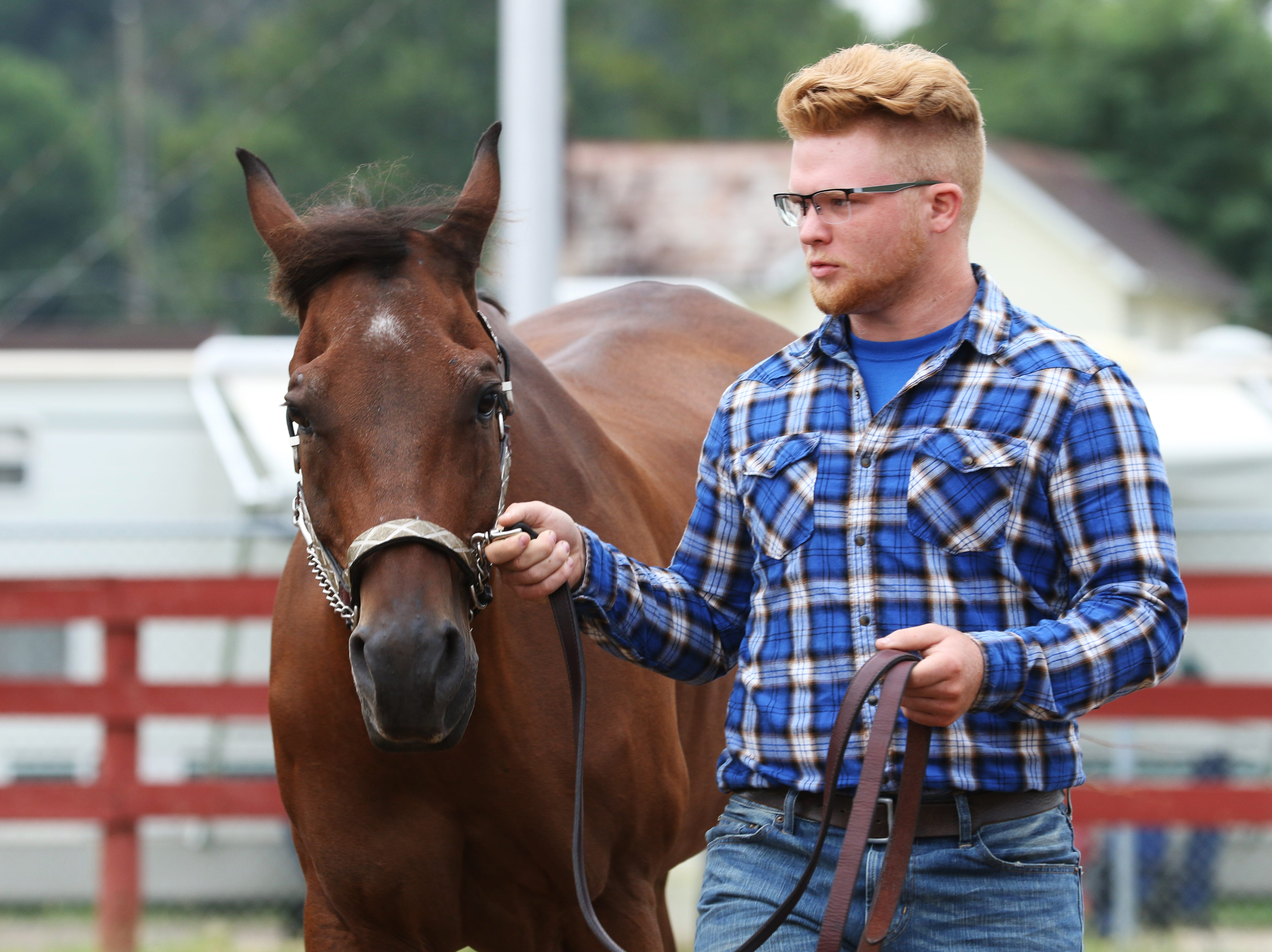Tyler McKenzie, 16, of Hopewell, shows a horse during the Showman of Showmen competition at the Muskingum County Fair on Friday.
