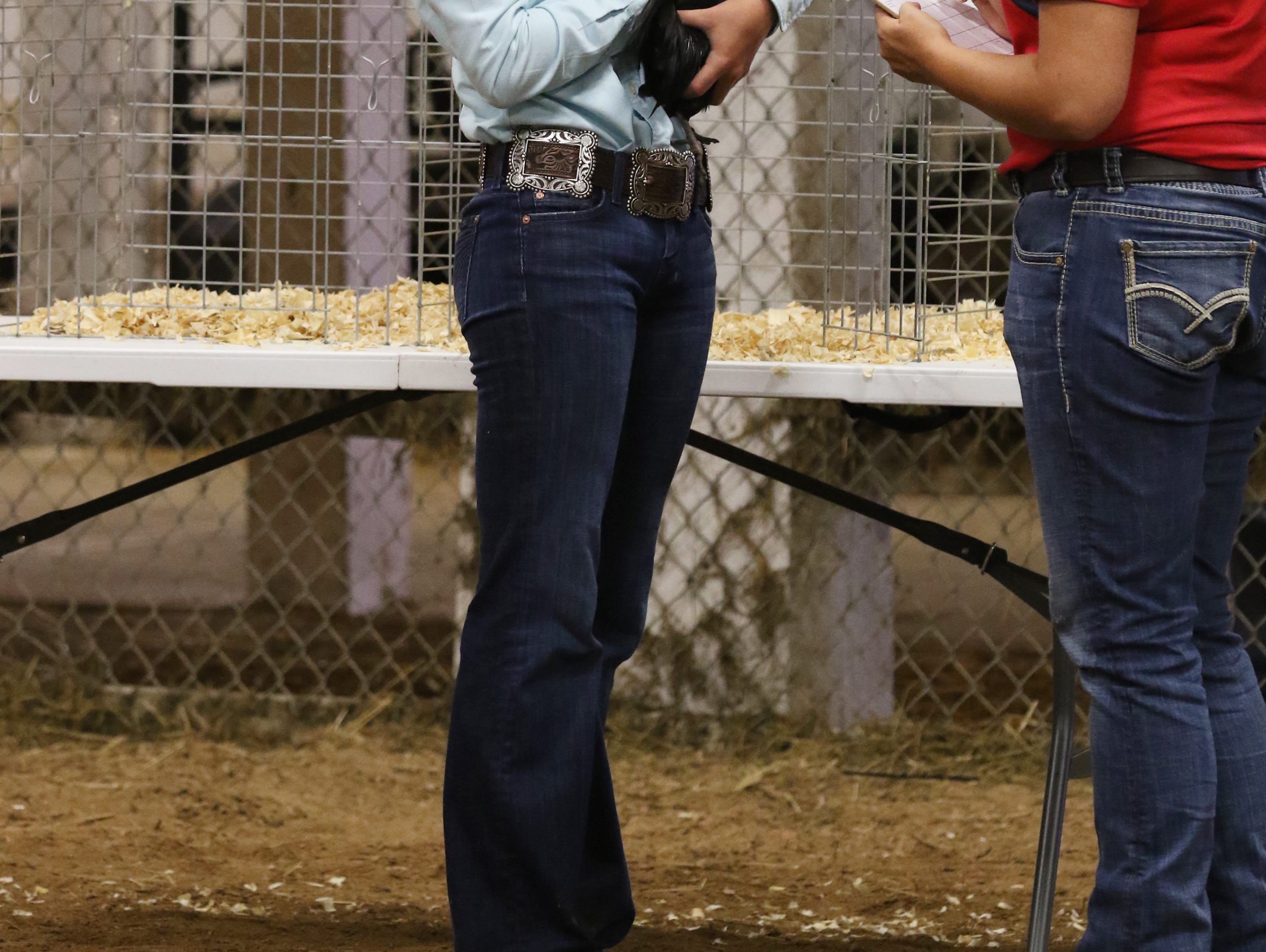 Kamryn Kreis shows a chicken during the Showman of Showmen competition at the Muskingum County Fair on Friday.
