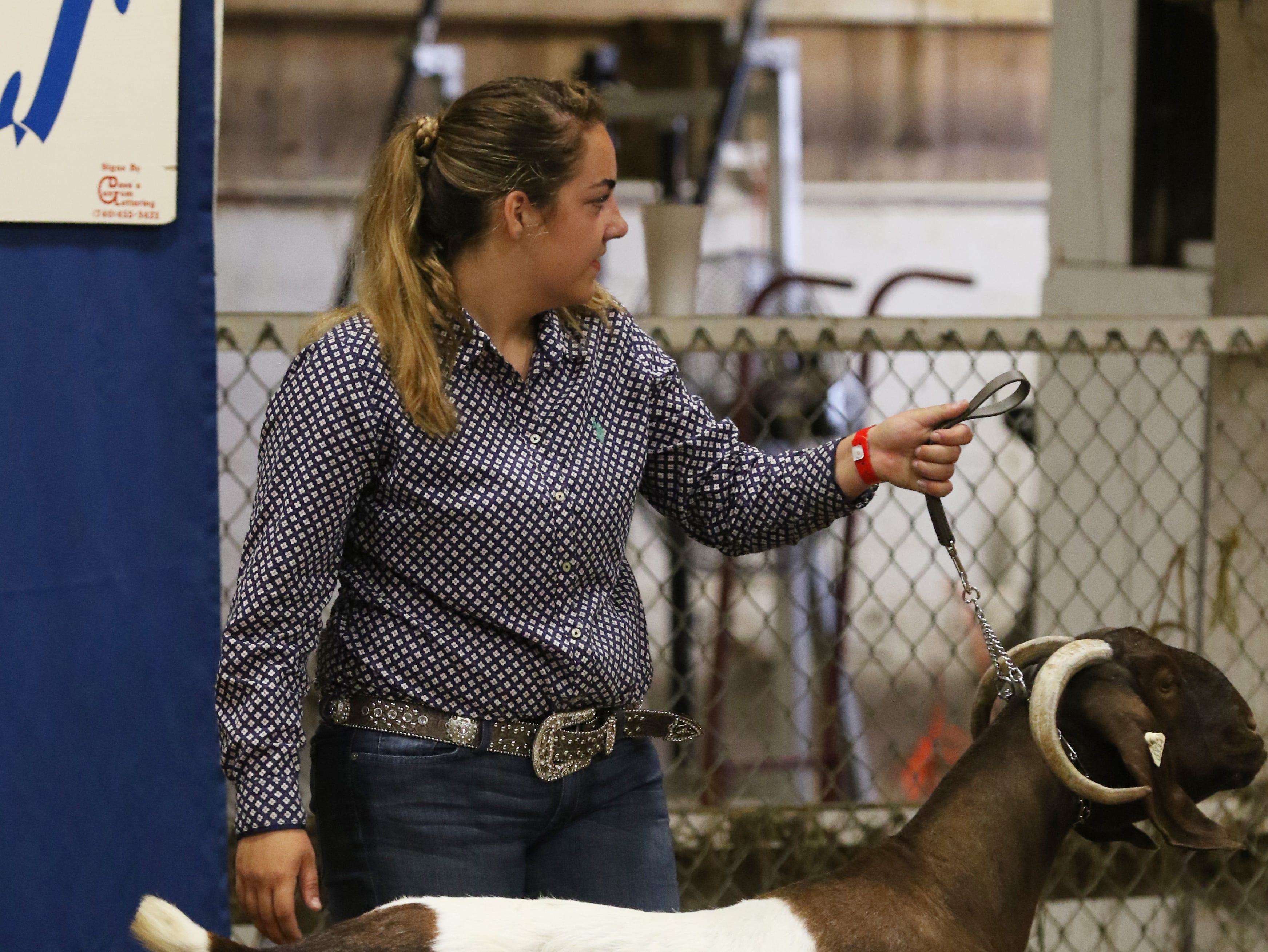 Brielle Vernon shows a goat during the Showman of Showmen competition at the Muskingum County Fair on Friday.