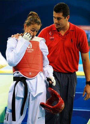 Jean Lopez, right, has coached siblings Steven Mark and Diana in the Olympics.