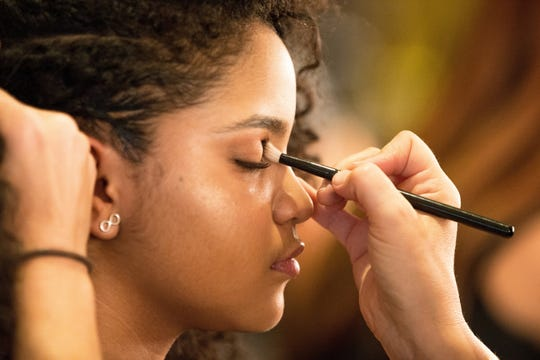 Singer Amanda Mena sits for makeup application before Tuesday's live broadcast of 'America's Got Talent.'