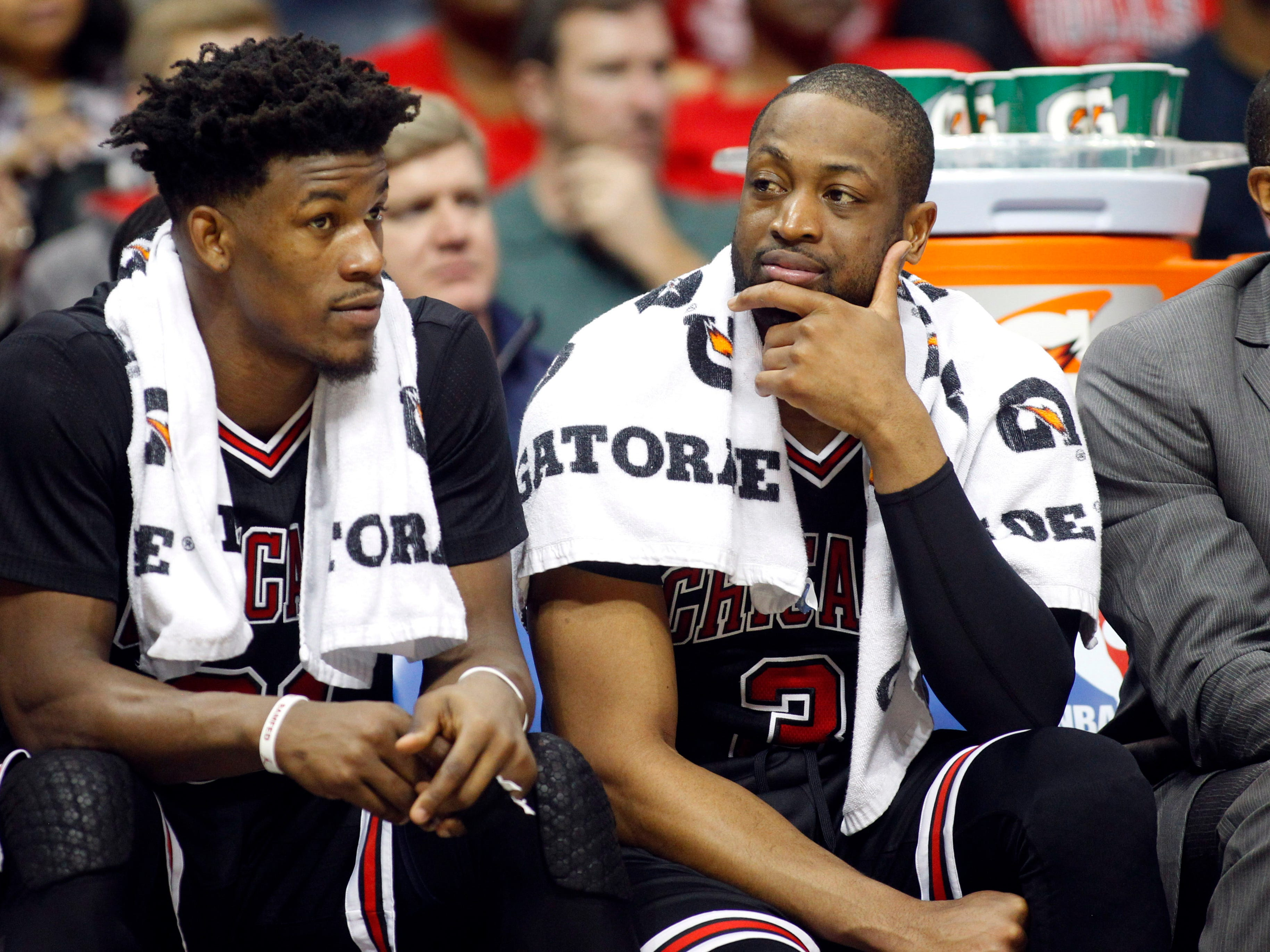 Former Chicago Bulls forward Jimmy Butler and guard Dwyane Wade talk against the Atlanta Hawks in the fourth quarter at Philips Arena in 2017.