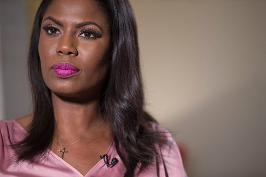 "Television personality and former White House staffer Omarosa Manigault Newman listens during an interview with The Associated Press, Tuesday, Aug. 14, 2018, in New York. The president called Manigault Newman ""a dog"" on Aug. 14."