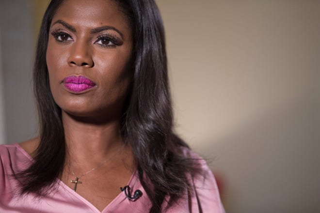 """Television personality and former White House staffer Omarosa Manigault Newman listens during an interview with The Associated Press, Tuesday, Aug. 14, 2018, in New York. The president called Manigault Newman """"a dog"""" on Aug. 14."""