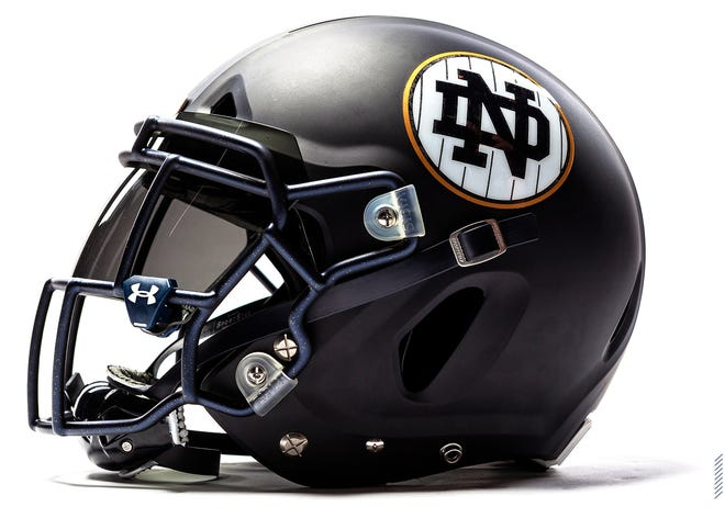Notre Dame unveiled a New York Yankees-inspired uniform combination for its game against Syracuse at Yankee Stadium.