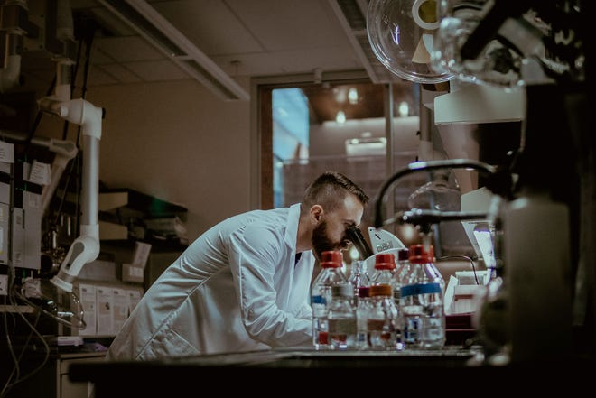 Researcher Charles Rolsky of Arizona State University, who was part of the team that looked into issues surrounding recycling of contact lenses, at work in the laboratory. Photo by Todd MacMillan