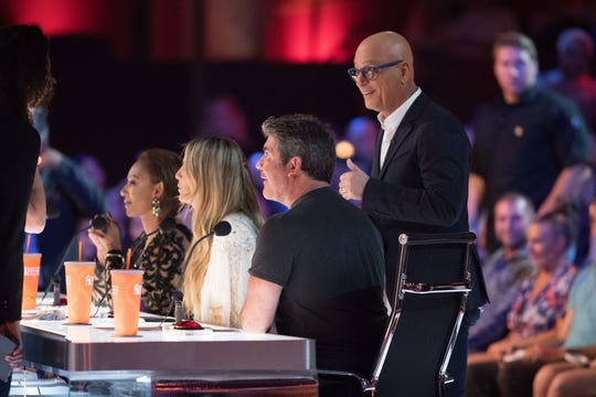 'America's Got Talent' judges Mel B, left, Heidi Klum, Simon Cowell and Howie Mandel, standing,  get ready for the start of Tuesday's live show.