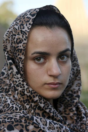 Yazidi woman Ashwaq Haji, allegedly used by the Islamic State as a sex slave, visits the Lalish temple in tribute to the jihadists' victims from her village of Kocho near Sinjar, in Lalish, northern Iraq, on August 15, 2018.  Haji, 19, says she ran into her captor in a German supermarket in February. Traumatized by the encounter, she returned to Iraq the next month.