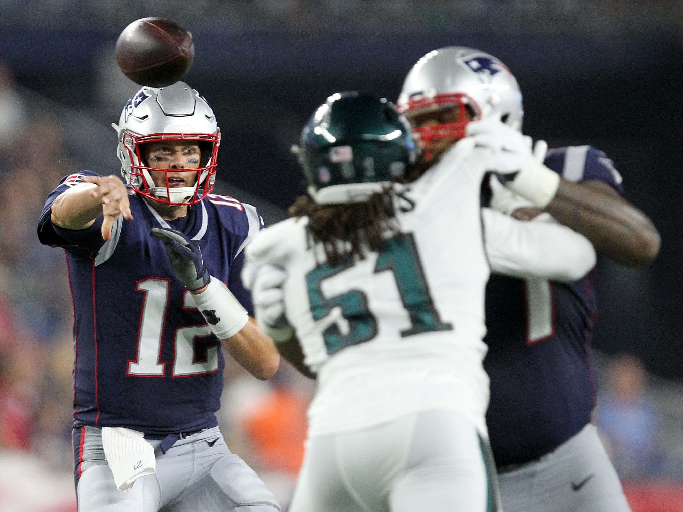 New England Patriots quarterback Tom Brady throws a touchdown pass to running back James White during the second quarter against the Philadelphia Eagles at Gillette Stadium.