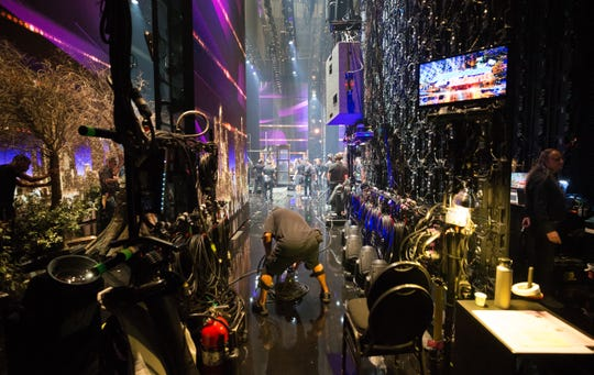 Props, sets, video dividing walls and black-clad crew members are seen from the wings during an Aug. 14 'America's Got Talent' dress rehearsal. The behind-the-scenes crew made an unplanned on-camera appearance Tuesday after a huge stage divider malfunctioned.