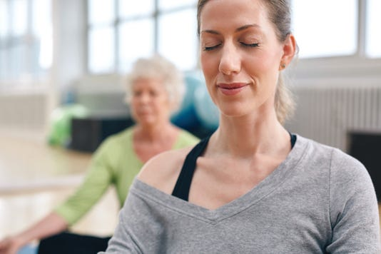 Relaxed Women In Meditation At Gym
