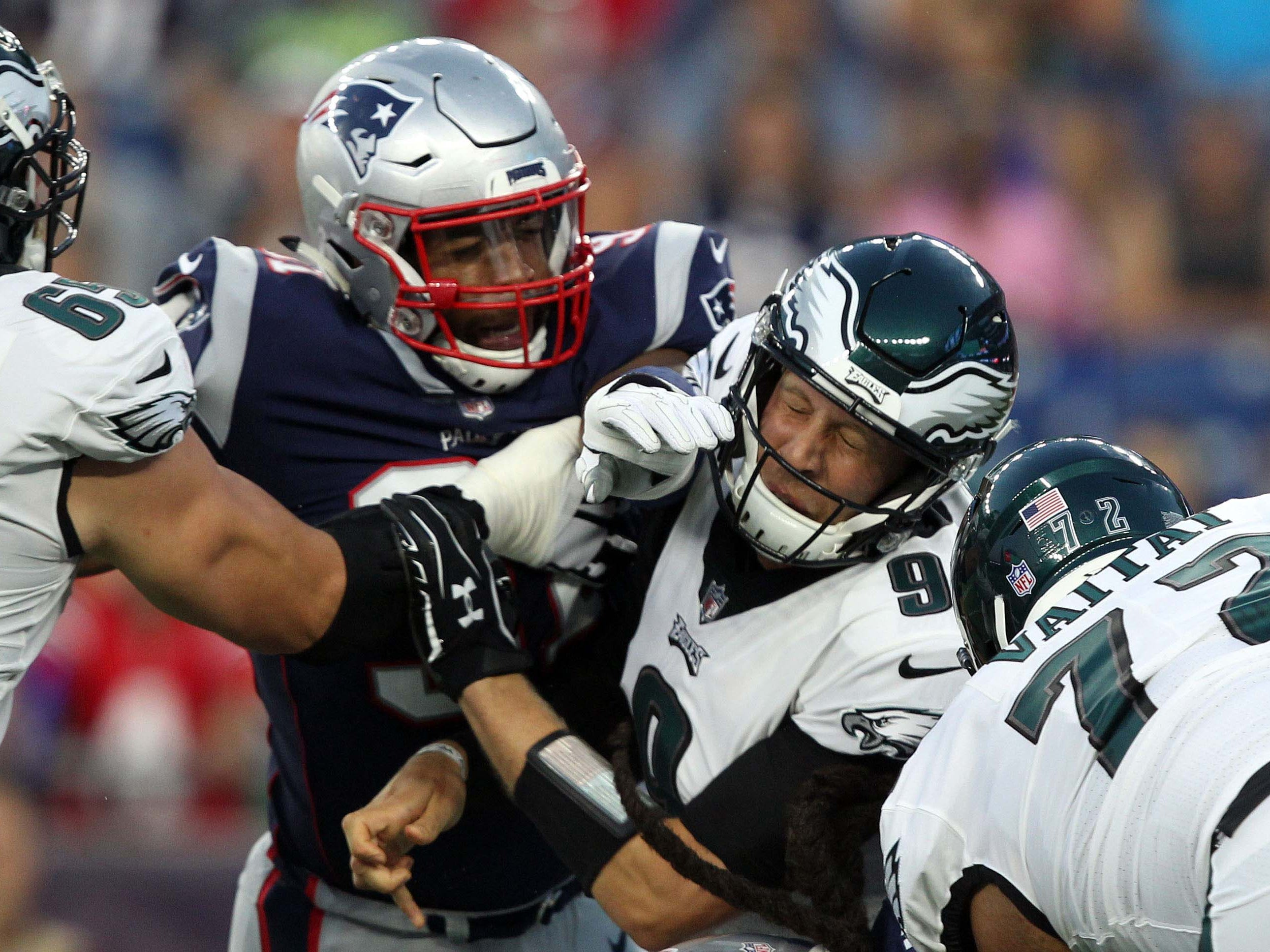 New England Patriots defensive end Deatrich Wise Jr. pressures Philadelphia Eagles quarterback Nick Foles during the first quarter at Gillette Stadium.