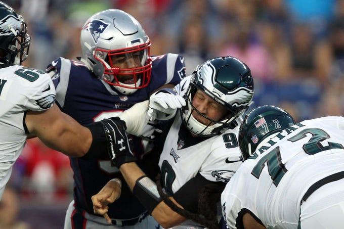 New England Patriots defensive end Deatrich Wise Jr. pressures Philadelphia Eagles quarterback Nick Foles during the first quarter at Gillette Stadium.