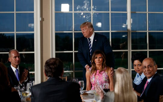 President Donald Trump with first lady Melania Trump at a dinner they hosted for business leaders, Aug. 7, 2018, at Trump National Golf Club in Bedminster, N.J.