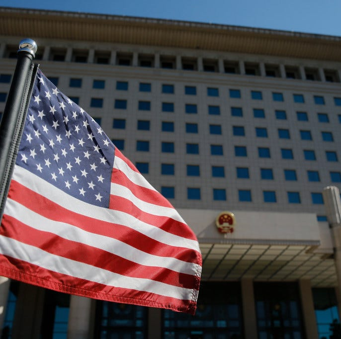 The US flag flutters on a diplomatic car after a meeting of US Defence Secretary Jim Mattis (R) with China's Vice Chairman of the Central Military Commission Xu Qiliang at the Bayi Building in Beijing on June 28, 2018.