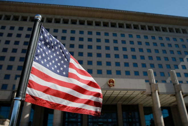 The U.S. flag flutters on a diplomatic car after a meeting of U.S. Defense Secretary Jim Mattis (R) with China's Vice Chairman of the Central Military Commission Xu Qiliang at the Bayi Building in Beijing on June 28, 2018.