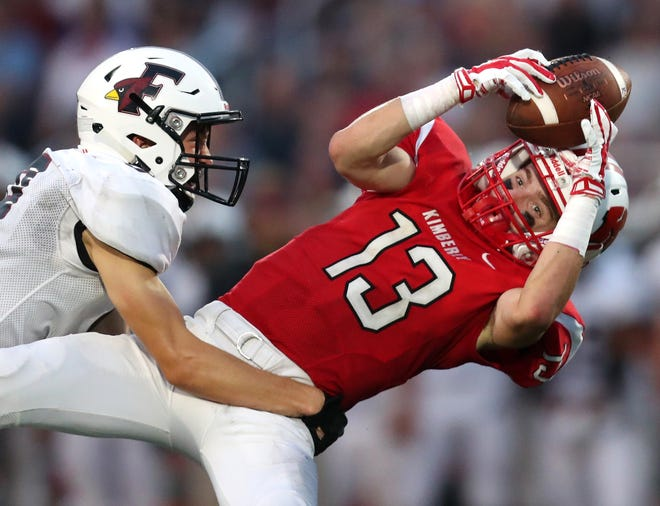 Kimberly's Zach Lechnir makes a catch as he is covered by Eli Sieckman of Fond du Lac on Friday at Papermaker Stadium in Kimberly.