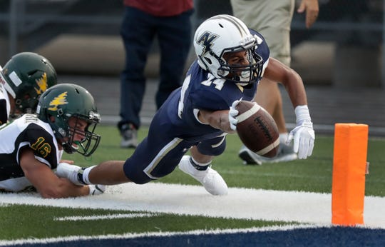 Appleton North's Ian Laatsch dives to score on a two-point conversion against D.C. Everest on Friday in Appleton.