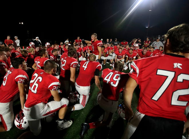 Kimberly's Nico de Boer talks to his team after their 31-28 loss to Fond du Lac on Friday, ending the Papermakers' 70-game winning streak.
