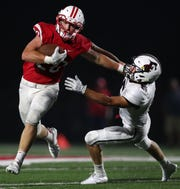 Kimberly's Will Fischer stiff arms Fond du Lac's Sam Hernandez during a game Aug. 17 in Kimberly.