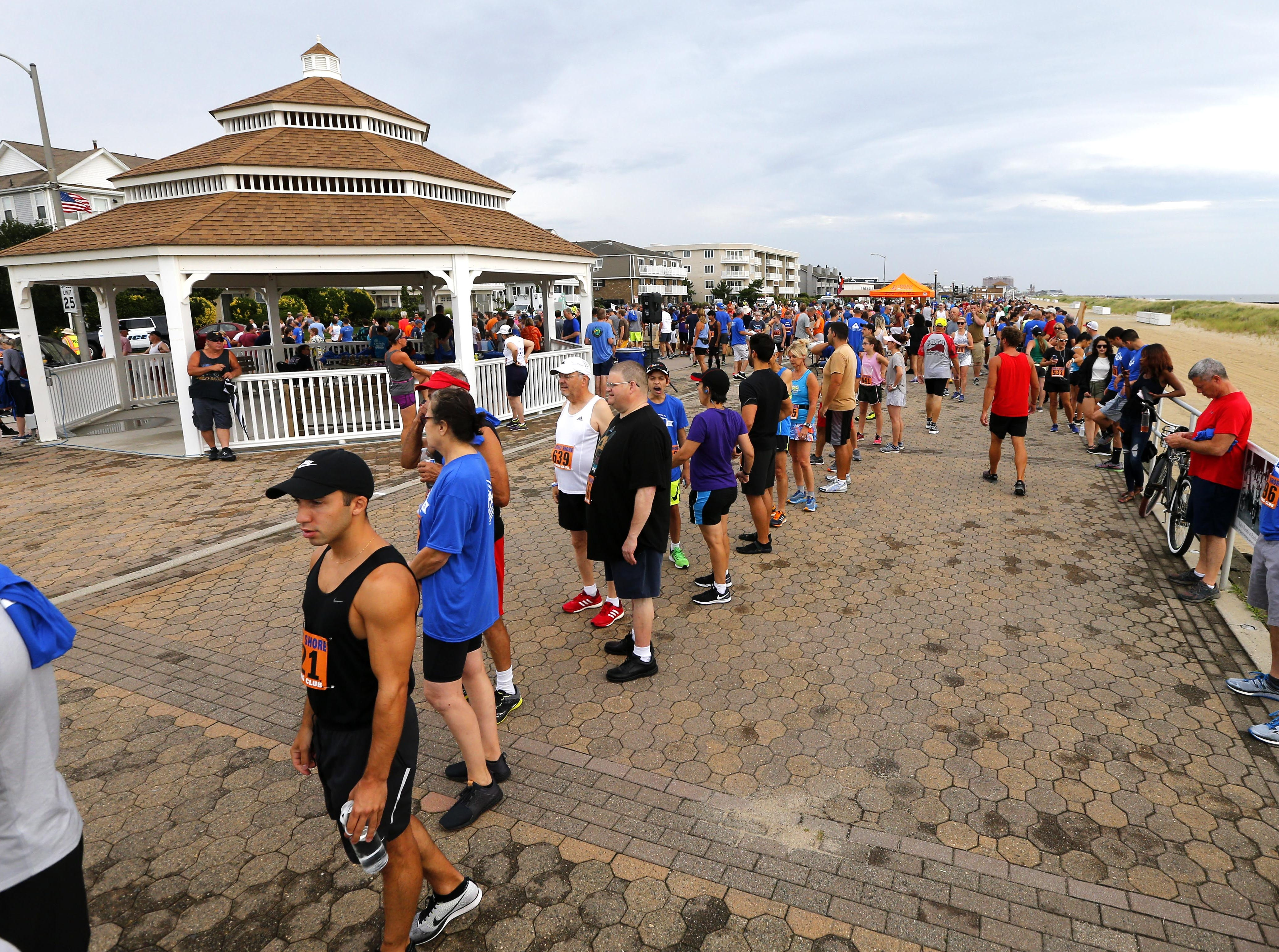 Runners prep for the Bradley Beach 5K race Saturday, Aug. 17, 2018.