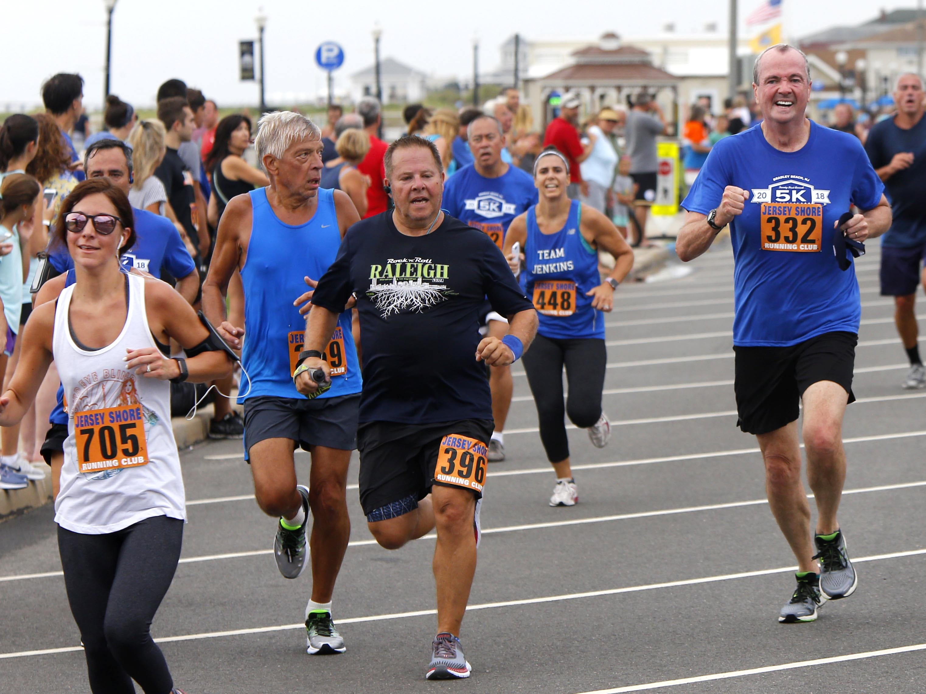 NJ Gov. Phil Murphy (right) approaches the finish line for the Bradley Beach 5K race Saturday, Aug. 17, 2018.