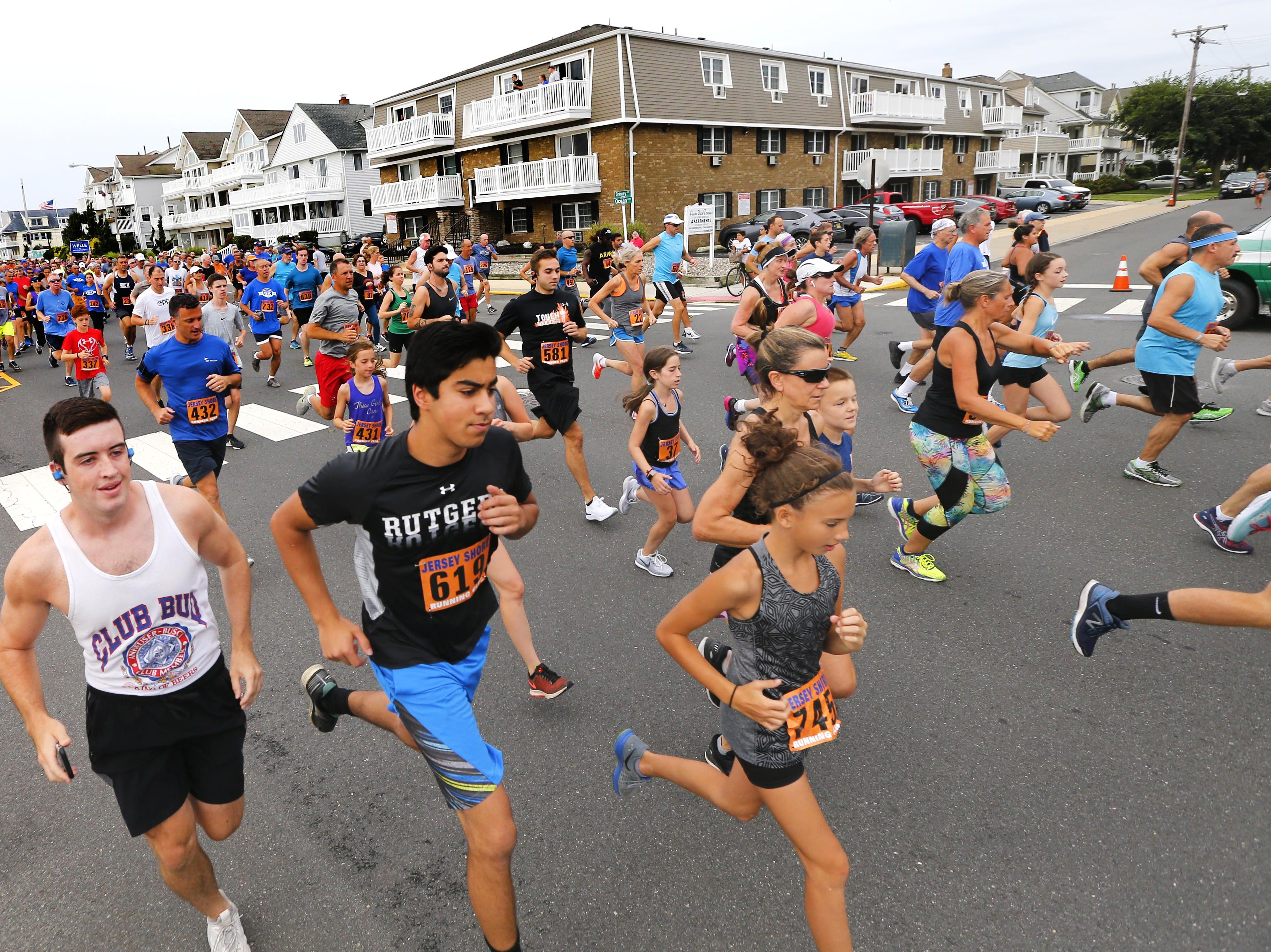 Runners participate in the Bradley Beach 5K race on Ocean Avenue in Bradley Beach, Saturday, Aug. 17, 2018.