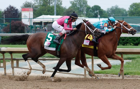 Wonder Gadot (No. 5), shown running second to Monomoy Girl in the Kentucky Oaks on May 4, will try and become the first filly in 103 years to win the Travers Stakes Saturday at Saratoga.