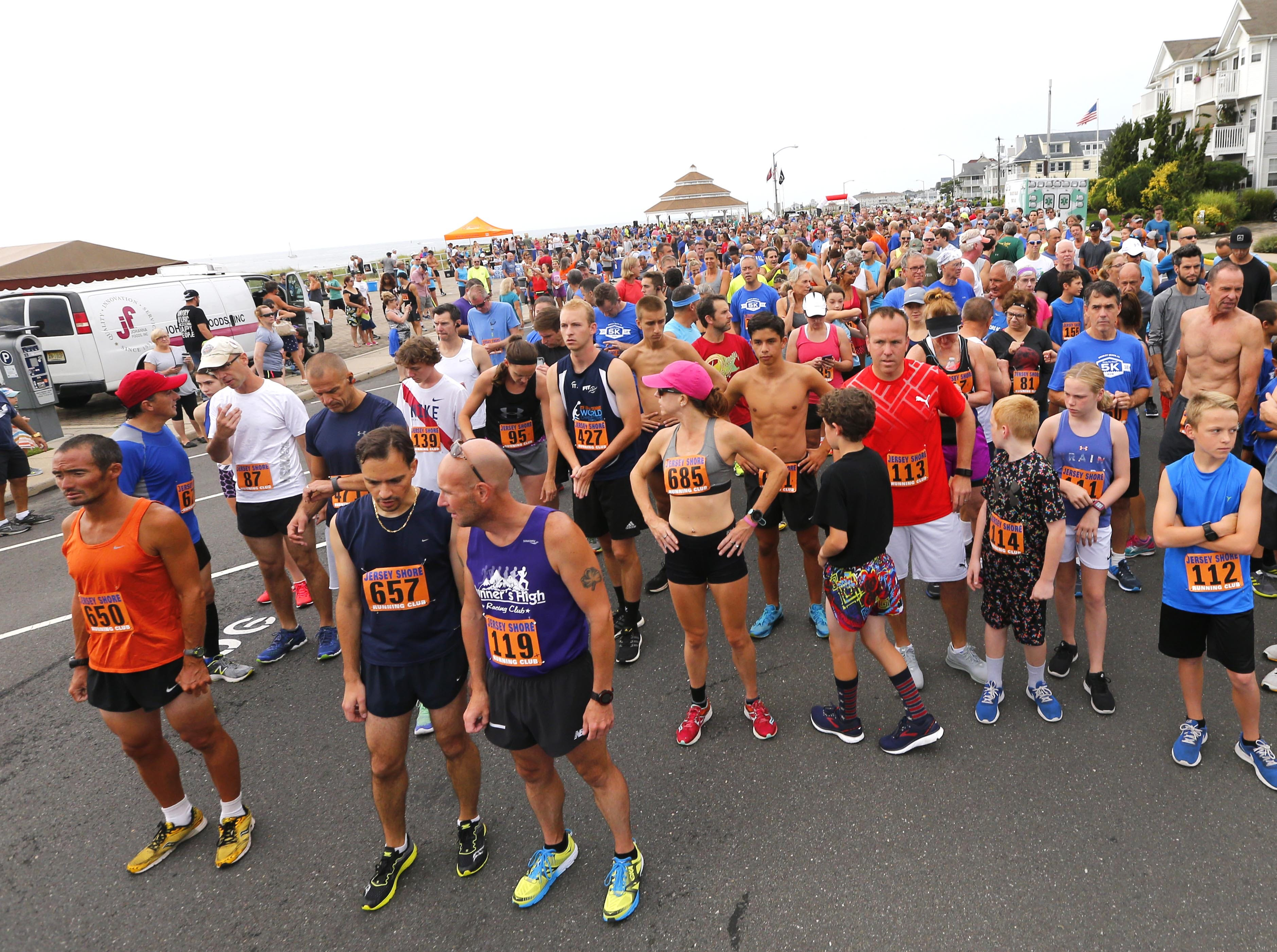Runners line up for the start of the Bradley Beach 5K race along Ocean Avenue in Bradley Beach Saturday, Aug. 17, 2018.