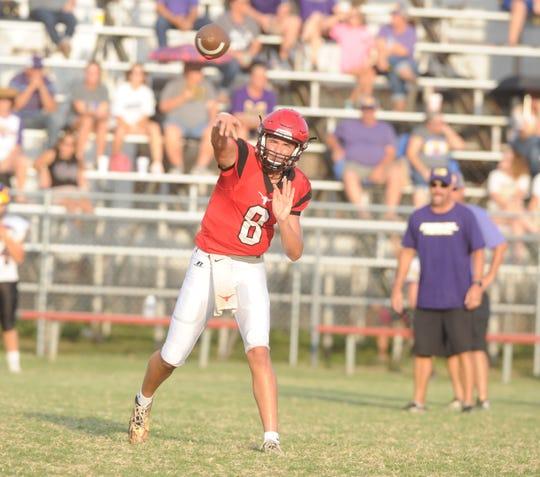 Eastland quarterback Behren Morton throws a pass during a scrimmage against Merkel Friday, Aug. 17 at Maverick Stadium.