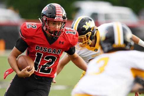Pisgah's Eric Robinson carries the ball in the game against Murphy August 17, 2018 in Canton. Pisgah won, 15-8.
