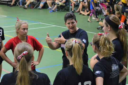 10-time state championship coach Vicky Groat talks to her  St. Philip team during the first weekend of volleyball season Saturday at the annual Carrie Adams Memorial Tournament in Battle Creek.