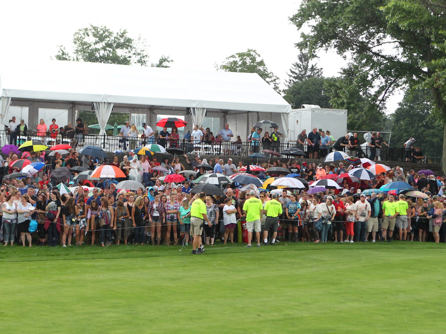Umbrellas were the standard equipment at the Blake Shelton concert.