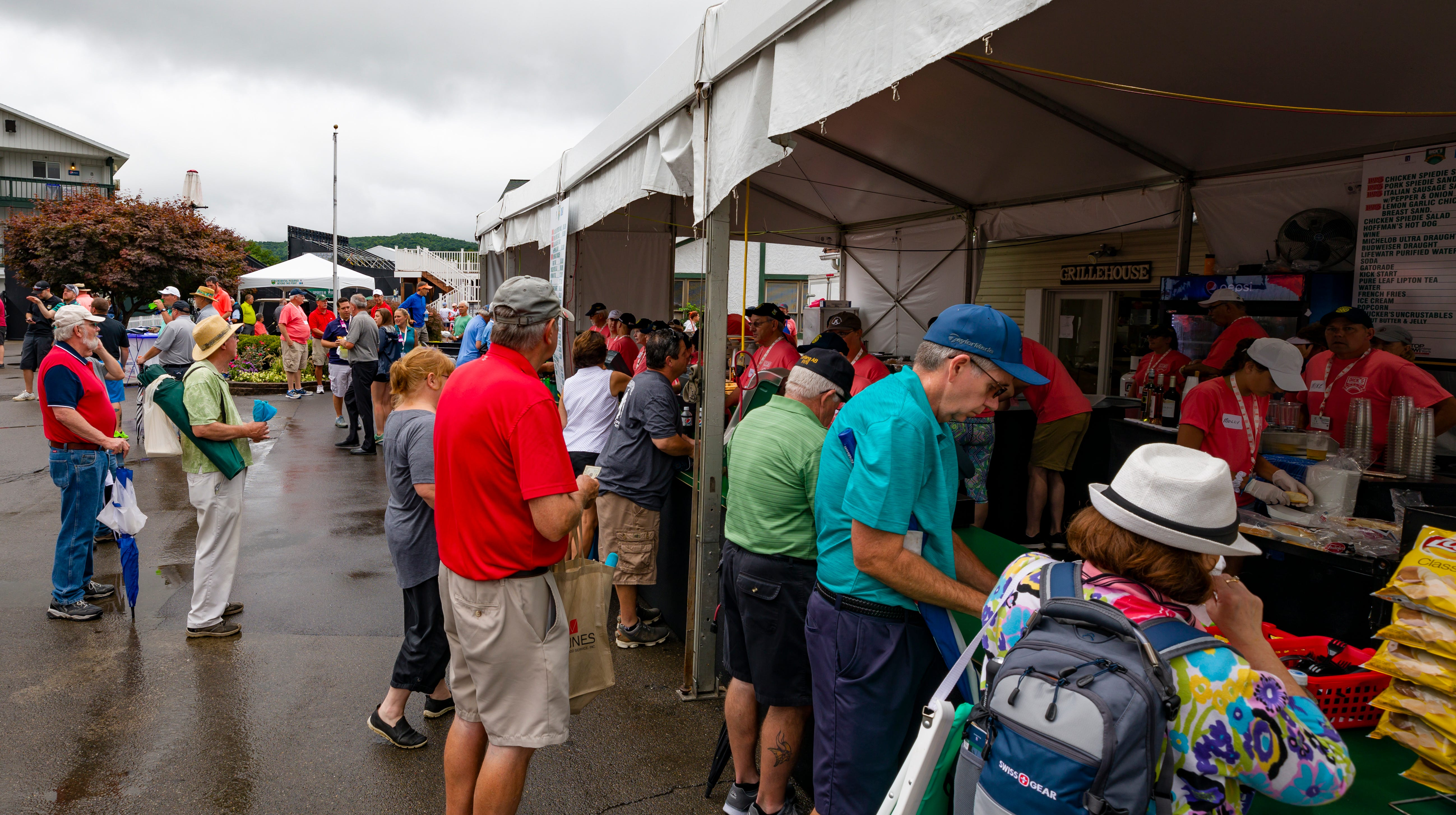 Fans made the best of wet conditions during a three hour rain delay at the Dick's Sporting Goods Open on Saturday.