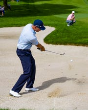 Bob Estes of Austin Texas hits out of the sand at the Dick's Sporting Goods Open on Saturday in Endicott, New York.