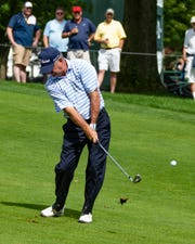 Bart Bryant of Winter Garden, chips to the green at the Dick's Sporting Goods Open on Saturday.