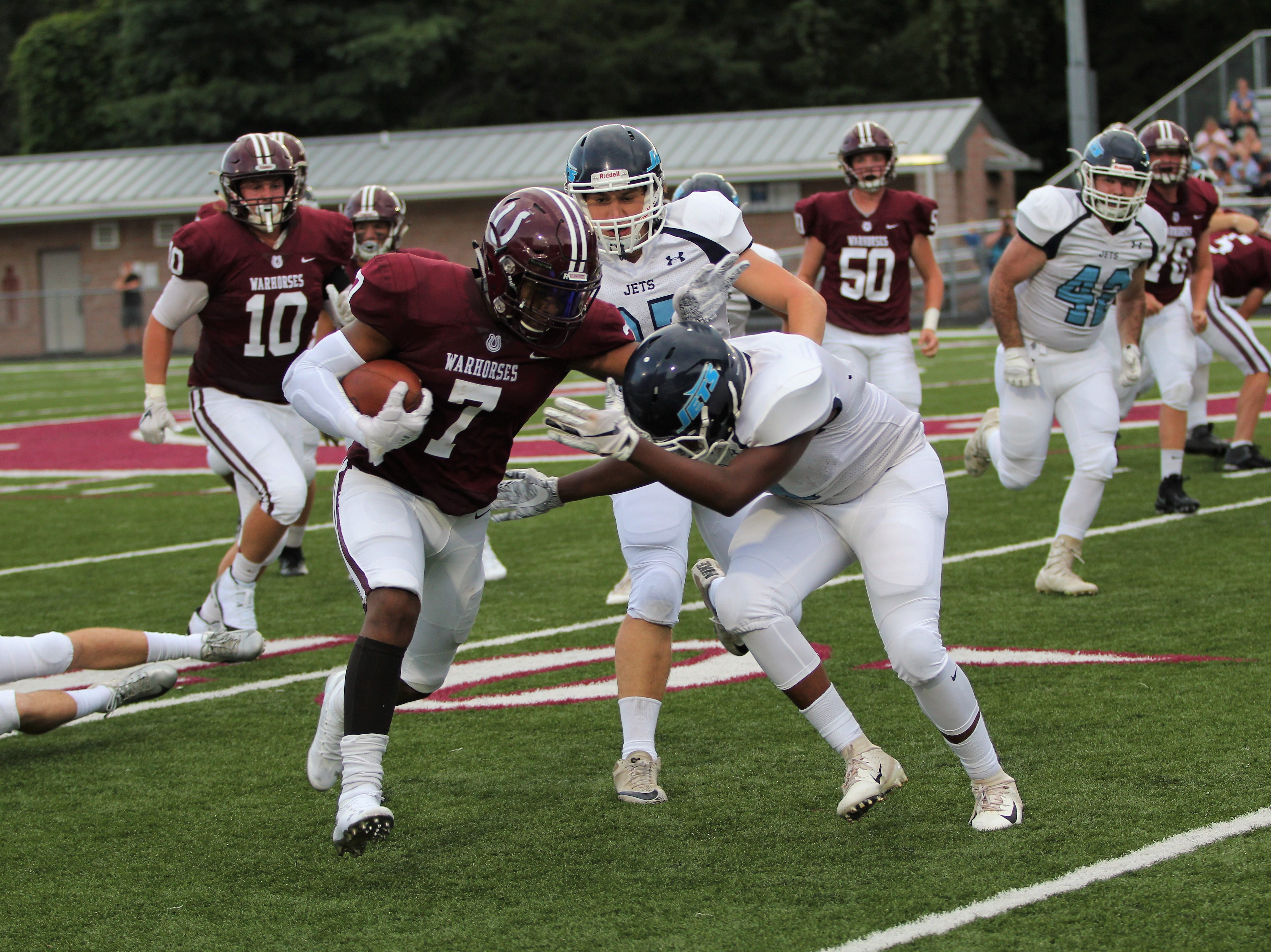 The Owen Warhorses opened the 2018 season with a 34-7 win over the Enka Jets at home on Aug. 17. The Warhorses were led on the field by Landon Cooper, who they visited at Swannanoa Valley Montessori School in April after he wrote them a letter. Coach Nathan Padgett dedicated the win to Cooper after the game.