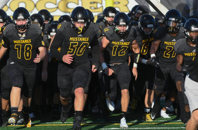 The Merritt Island Mustangs take the field for their season opening game Friday evening.